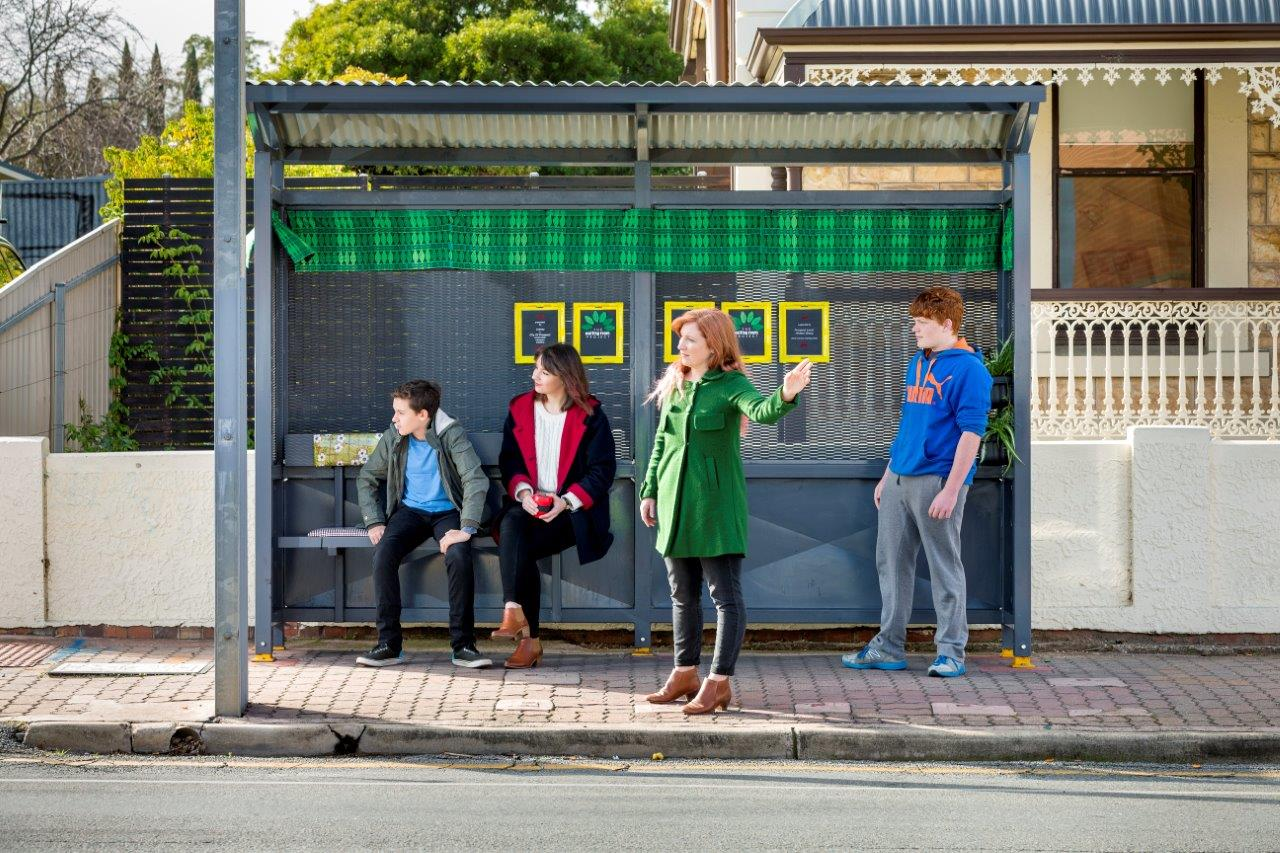People waiting at a bus stop